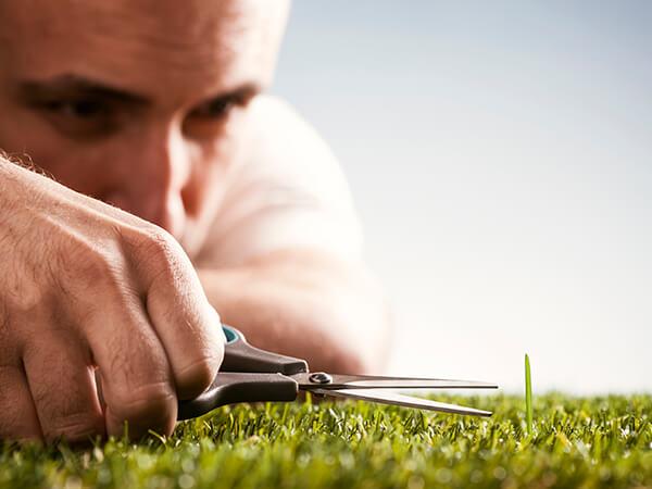 erp implementation detail 01 man cutting grass with scissors