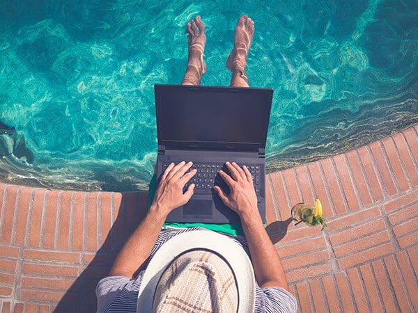 ERP Software on a laptop by a pool