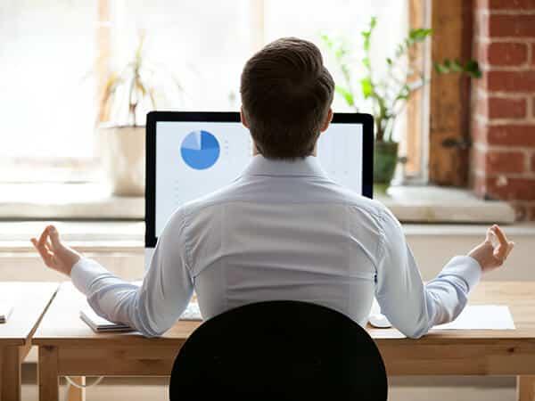 Man meditating over Distribution ERP Software